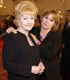 Debbie Reynolds and Carrie Fisher during St. Jude Runway For Life - Red Carpet at Beverly Hilton Hotel in Beverly Hills, California, United States.