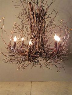 This branch chandelier is a cool way of bringing natural elements into any space. It makes for a more rustic look and brings a feel of autumn to any home. Twig Chandelier, Chandeliers, Chandelier Wedding, Diy Décoration, Easy Diy, Simple Diy, Christmas Village Display, Christmas Christmas, Christmas Villages