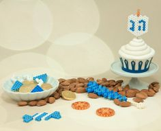 Create these fun designs with Perler beads to celebrate Hanukkah—a dreidel cupcake topper, candies, and gelt. A fun activity for the whole family to celebrate the Festival of Lights!