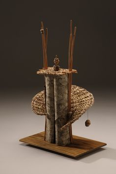 Polly Jacobs Giaccina | 'Tower Swirl'  Date palm, bark, willow and clay bead, on wood base