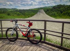 """Our Bike in front of the Mud Volcano - """"Biking the Maranello Hills, a Devine Alternative to Tuscany"""" by @ThePlanetD Travel"""