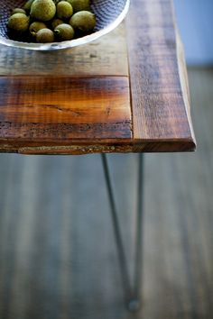 Reclaimed wood table on hardwood floors in a model home.  Purchased from Sandtown Millworks in Baltimore Maryland.