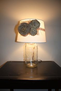 Repurposed Mason Jar lamp with burlap flowers by AnchorandLace, $52.00 - lamp needs to be filled with something, what?