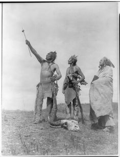 The Oath--Apsaroke. Date Created/Published: c1908 November 19. Summary: Three Apsaroke men gazing skyward, two holding rifles, one with object skewered on arrow pointed skyward, bison skull at their feet. Photograph by Edward S. Curtis, Curtis (Edward S.) Collection, Library of Congress Prints and Photographs Division Washington, D.C.