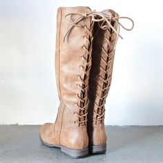 5e8796749b39 Amazing tones of black grey   tan adorn these tall laced up riding boots.  Features