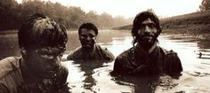 Scott and Bob look happy to be covered in mud, while Seth looks pissed