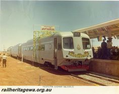 Prospector railcar set, breaking through banner at Kalgoorlie station, Inauguration of the Prospector service. Image Rail Heritage WA