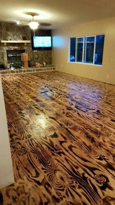 Burnt plywood floor, routed out plank lines, Love it