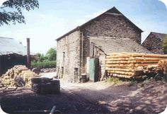 The original Playdale factory in an old timber yard in Bridge End. Vintage Photography, Playground, This Is Us, Bridge, Yard, Cabin, History, The Originals, House Styles