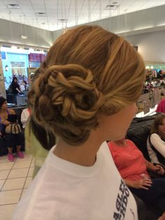 Long hair side bun I did several loose braids  and the pinned them up to hide some if the hair she had thick hair @Visible Changes Salons