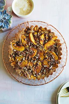 Brown Sugar Peach Buckle - this easy summer cake envelopes sweet peaches with a rich brown sugar and brown butter cake batter that's…