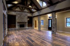 living room- gorgeous! love the exposed beams and the stone