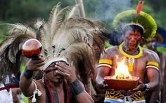 A Terena man cries as he remembers their dead during the Kari-Oca opening ceremonyPicture: ANTONIO SCORZA/AFP