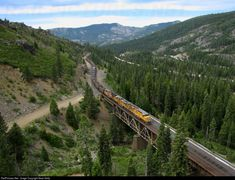 An empty unit coal train winds its way upgrade through a long series of curves and then out onto Butte Canyon Bridge, just west of Shed 10 on the west side of Donner Pass. Location Map, Photo Location, Union Pacific Railroad, Cloudy Day, West Side, Train Tracks, Bridges, Empty, Trains