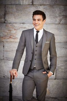 Gray 3-piece suit, white dress shirt, and black skinny tie with white pocket square.