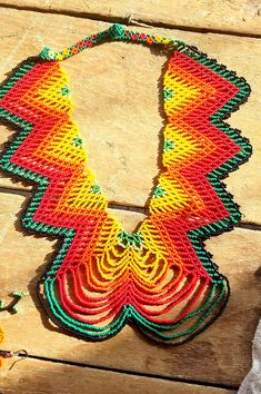 Beautifully hand crafted beaded Bib Necklace This authentic Huichol necklace is made by authentic artisans from the native tribe with ancient unique technique and design. Elaborate and intricate designs makes this necklace one of a kind. Bright and vibrant colors are absolutely