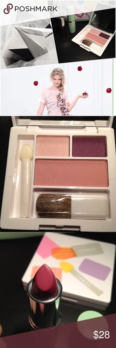 Clinique make up travel kit Comes with eyeshadow duo and blush compact with mirror, nail polish, and lipstick. All unused. Comes in a little makeup case. Clinique Makeup