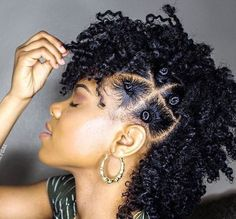 Bantu Knots on the side; @kinkycurlygal