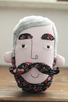 pillow faces. Awesome! cool vintage geek chic contemporary retro home decor plushie pillow head love the floral fabric moustache and beard