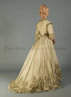 1865 dress.  I believe the designs are made from those awesome beetle wings (jewel beetles?).