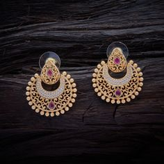 Designer CZ Zircon Hanging earrings studded with Ruby synthetic stones, with gold Polish.
