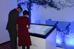 KPMG @ WEF 2014: WEF participants exploring the KPMG WEFLIVE interactive touch screen
