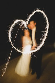 We HEART this couple's sparkler skills  Photography by http://amyarrington.com