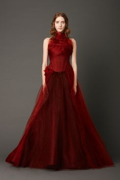 Crimson strapless mermaid gown with corset bodice and honeycomb tulle skirt with hand-rolled floral embellished detail