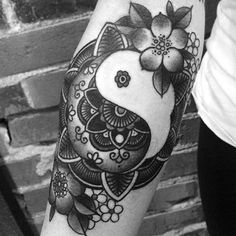 Yin Yang tattoo showcasing the sun and the sea. There are many things that a Yin Yang can convey and one of the most popular concepts is the fire and water connection.