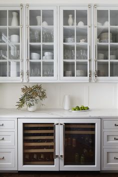 Elegant butlers pantry - statement hardware and glass front cabinets and materials pulled in from the kitchen