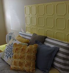 Styrofoam tiles (intended for the ceiling) for around $20, painted yellow, and attached to the wall with sticky adhesive squares. (Another use for the Styro tiles I just featured on Epbot! Just be careful; the foam will dent if crushed.)