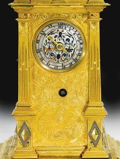 A gilt-metal quarter striking astronomical table clock, Augsburg, circa 1600