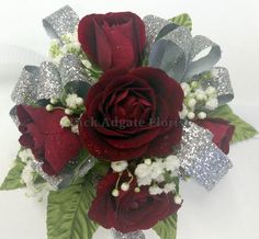 Deep red sweetheart roses with babies breath and silver ribbon. Prom / homecoming flowers on a wrist corsage. Dick Adgate Florist origianl.