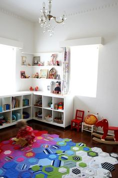 Fun, colorful kids playroom...love the idea of a quilt on the floor over a nice pad.