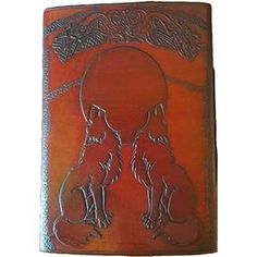 Embossed on this large journal are two wolves howling at the moon as bats fly across the night sky. The book is broadly edged with embossed Celtic scroll and kn
