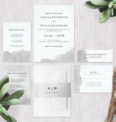 This minimalist wedding invitation suite features a gray watercolor look design with modern black text.