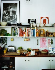 small kitchen. i like the idea of hanging mugs on hooks under the cabinets, to save  space.