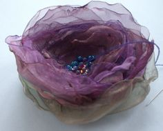 organza flowers...how to!                                                                                                                                                                                 More