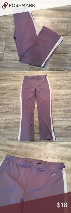 Women's Nike Pants Perfect condition like new pants in women's small. Zip up front. Very sleek and flattering on. Nike Pants