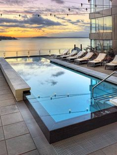 Infinity pool and rooftop views of Elliott Bay from the Four Seasons Seattle.