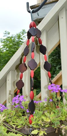 Red and brown beaded hanging basket wire by statementbyemily
