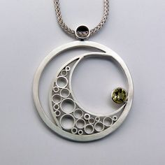 """Circles"" pendant by Pat Daugherty. Sterling silver and 5mm yellow quartz"