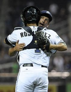 Game #112 8/6/12: Huston Street #16 of the San Diego Padres is congratulated by Eddy Rodriguez #1 after getting the final out during the ninth inning of a baseball game against the Chicago Cubs at Petco Park on August 6, 2012 in San Diego, California. The Padres won 2-0. (Photo by Denis Poroy/Getty Images)