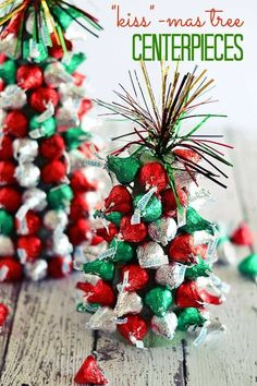 "In the holiday spirit for a festive centerpiece, but aren't super crafty? These ""Kiss""-mas Tree Centerpieces made with Hershey's Kisses are super easy to make and are a fun project to work on with kiddos! 
