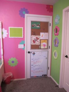 Pink, Pink, Pink!, We suprised our 7 year old for her Birthday with a room makeover! She loves pink so we decided on a comforter set and went from there!! , Behind her door. She wanted a place to hang pictures and draw. We found these boards at Costco and they fit nicely on the back of the door. The white board is magnetized. Mirrored flowers were from a dollar store.  , Girls Rooms Design