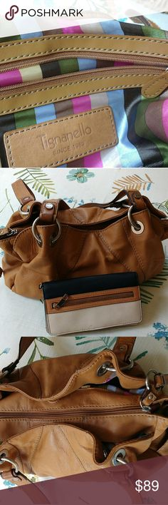 Tignanello satchel Tignanello buttery soft leather handbag. Pretty satin striped interior. One big zipper compartment and two outer compartments that have magnetic snaps.  Zipper pocket and cellphone pockets.  The wallet is yours if you'd like it it does have a small imperfection. The handbag has a tiny spot, not very noticeable you may be able to remove with leather cleaner. Only used a few times.  I use my black leather more often  😸 the color is cognac. Tignanello Bags Satchels