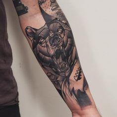 Growling bear arm tattoo idea