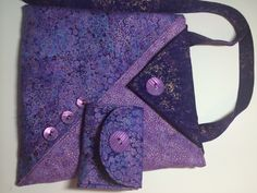 This bag is made of a beautiful purple batik cotton fabric in coordinating colors. It is fully lined with matching fabric with a large inside pocket. The outside flap is Velcro closure. The strap is 45 inches long. The bag comes with a matching trifold wallet. The wallet has three card pockets and a coin pocket with a Velcro closure. The wallet measures 4.25 in. w. x 8.5 in. H. when opened and 4.25 in, x 3.25 in. closed. The set is priced at 35.00.