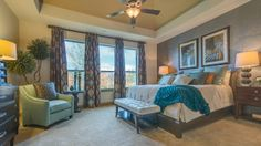 Pretty brown and teal candlesticks in this bedroom by Darling Homes at Mustang Park in Carrollton. #new #home #candles #brownandtealroom #bedroomdesign #decorativecandles #carrollton