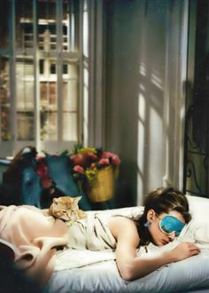 Audrey Hepburn as Miss Holly Golightly - I love the sleeping mask and earplugs :-)